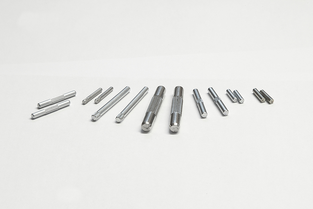 Smooth and knurled pins